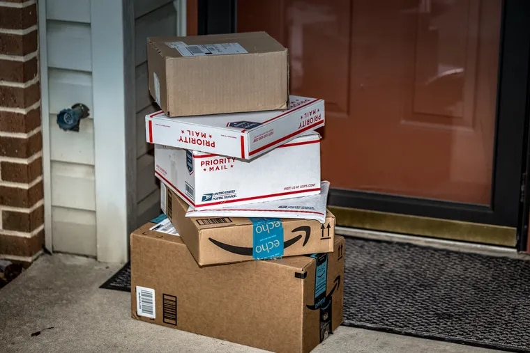 Packages stacked on top of each other at the front door of an apartment building. Effective July 1, Pennsylvania will now require any company selling more than $100,000 worth of product (or 200 transactions) into the commonwealth to collect and pay in sales tax.