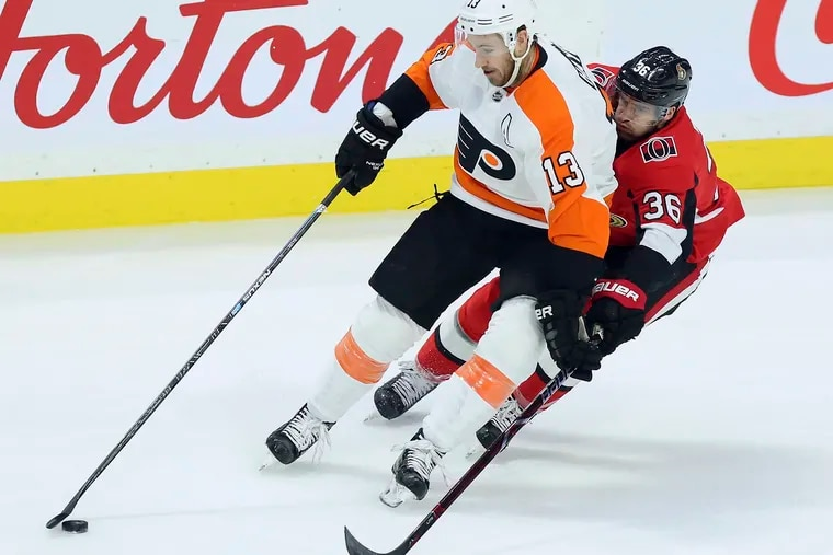 Kevin Hayes protects the puck from Ottawa's Colin White during the first period of Saturday night's Flyers' victory.