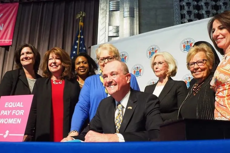 Gov. Phil Murphy last year signed the Diane B. Allen Equal Pay Act into law, giving New Jersey one of the strongest equal pay laws in the country. Immediately behind him are Allen (left) and activist Lilly Ledbetter, after whom a federal equal-pay law is named.