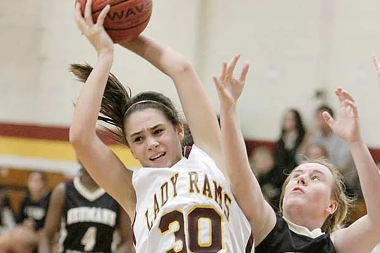 Gloucester Catholic's Mary Gedaka (30) and Neumann-Goretti's Cara McHenry (12) battle for a rebound late in the second quarter. (Elizabeth Robertson/Staff Photographer)