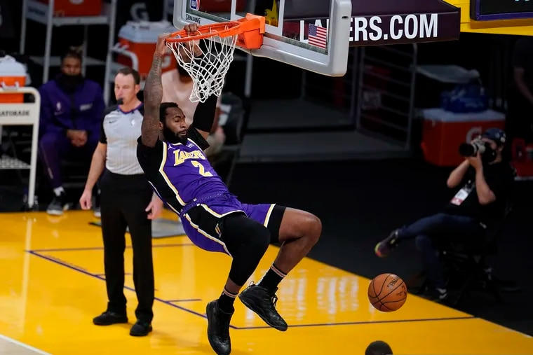 Los Angeles Lakers center Andre Drummond dunks against the Sacramento Kings during the second half of an NBA basketball game Friday, April 30, 2021, in Los Angeles.