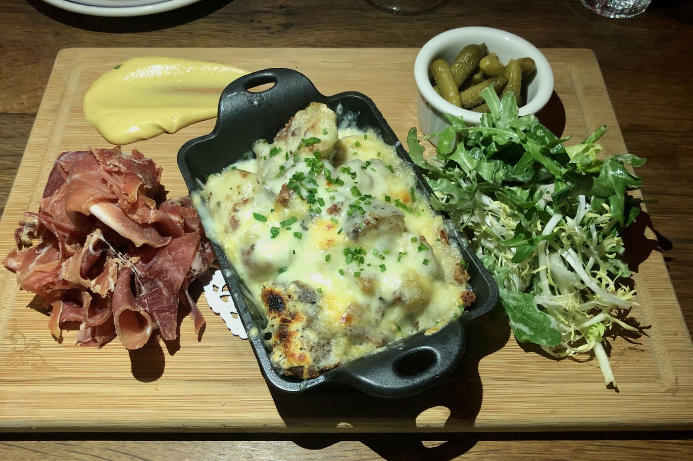 At Good King Tavern, Sundays the French bistro way, with hot raclette and weird wine