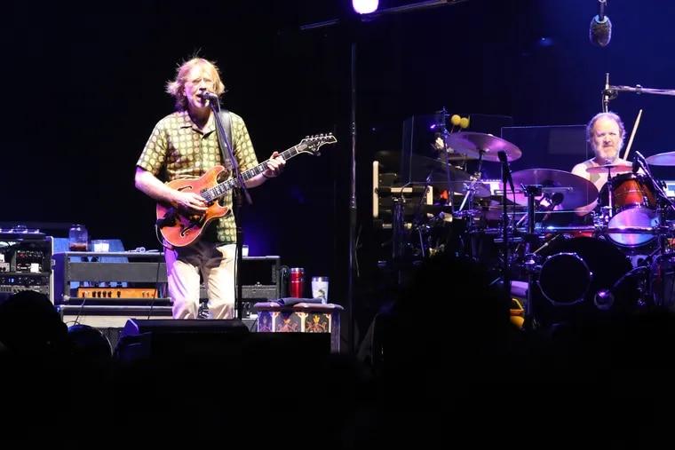 Phish lead guitarist Trey Anastasio, drummer Jon Fishman, and the band, perform on the beach in Atlantic City Friday night.