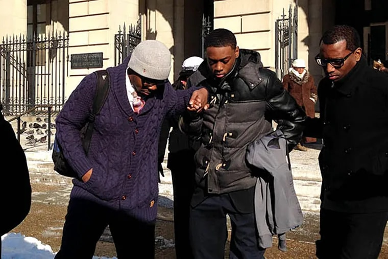 Darrin Manning, 16, gets help leaving Family Court yesterday after a hearing. His case, in which a female officer allegedly ruptured his testicle during frisking, has drawn national attention. HELEN UBIÑAS / DAILY NEWS STAFF