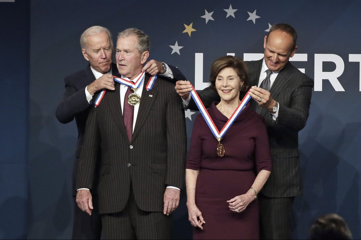 Ex-President George W. Bush, wife Laura receive Liberty Medal amid protests