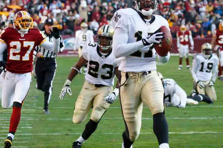 The Saints' Robert Meachem runs for a TD on a double-turnover play. Meachem stripped the football from Kareem Moore after the Redskins' Moore intercepted a pass by Drew Brees.