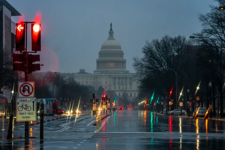 The Capitol is seen on a rainy morning in Washington, Friday, Dec. 28, 2018, during a partial government shutdown. President Donald Trump is threatening to close the U.S. border with Mexico if Democrats in Congress don't agree to fund the construction of a border wall.