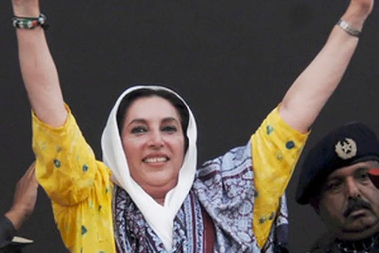 Bhutto greets the crowd . She accused Musharrafof not crushing militants.