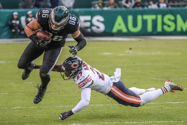 Eagles tight end Zach Ertz reaches for the extra yardage after being hit by ChicagoÕs Sherrick McManis, right, and made enough for a first down and kept the final drive alive against the Chicago Bears at Lincoln Financial Field.