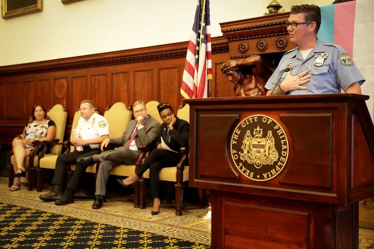 Police Officer Jo Mason, right, president of the Philadelphia chapter of the Gay Officer Action League, speaks during a news conference at City Hall on Tuesday, June 25, 2019, at which Philadelphia Police unveiled an updated policy for how to interact with people who identify as transgender or nonbinary.