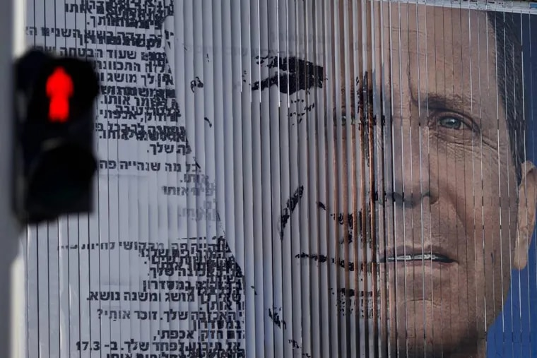 File: An election campaign billboard shifts between images of Isaac Herzog, leader of the Labor Party, right, and Israel's Prime Minister Benjamin Netanyahu and leader of the Likud Party, in Tel Aviv, Israel. As no candidate is likely to win big in the wild jumble of Israel's political landscape, the outcome of the March 17 election could well be a joint government between Netanyahu and his moderate challenger Isaac Herzog. (AP Photo/Ariel Schalit)
