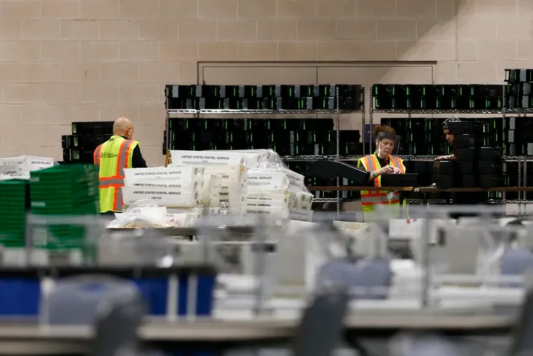 Workers prepare mailed and absentee ballots at the Pennsylvania Convention Center in November 2020.