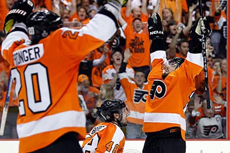 The Flyers' Ville Leino celebrates his third period goal with Danny Briere and Chris Pronger. (Yong Kim / Staff Photographer)
