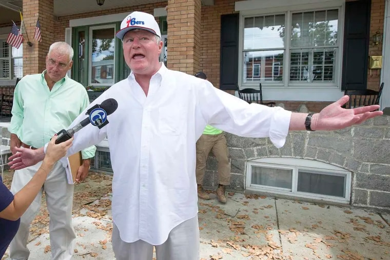 IBEW Local 98 union leader John J. Dougherty spoke to reporters as FBI agents conducted a search of his home on Aug. 5, 2016, as part of an extensive federal investigation. Prosecutors are expected to announce the results of that investigation on Wednesday.