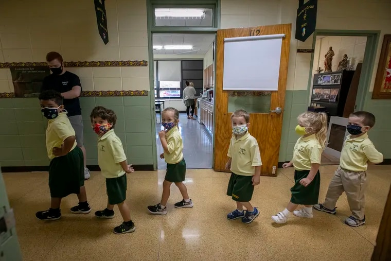Pre-K4 students with face masks walk through the hallway at Nativity. Nativity of Our Lord School in Warminster, PA in the age of COVID-19, on Wednesday, September 23, 2020.