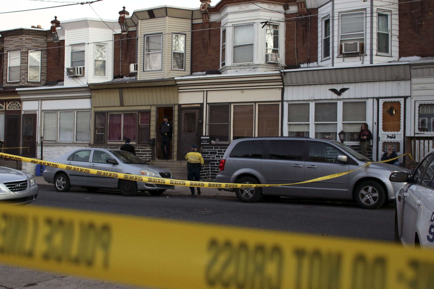 Police: 2 men found slain in a Harrowgate house's dining room