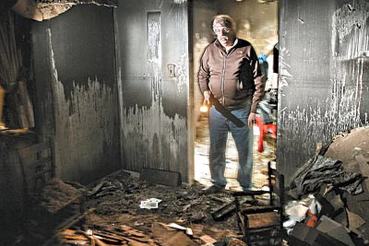 Jim Reilly returns to his burned-out Boothwyn house, where he sometimes looks for old treasures amid the rubble. Besides losing his home to fire, he has lost his wife, a son, and his job. (MICHAEL BRYANT / Staff Photographer)