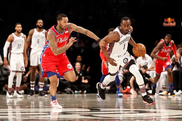 Philadelphia 76ers forward Mike Scott (1) defends against Brooklyn Nets guard Theo Pinson (1) during the first quarter.