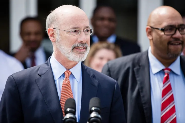 Gov. Tom Wolf (left) and Corrections Secretary John Wetzel. Both resist the use of reprieve to reduce the prison population in response to rising coronavirus deaths.