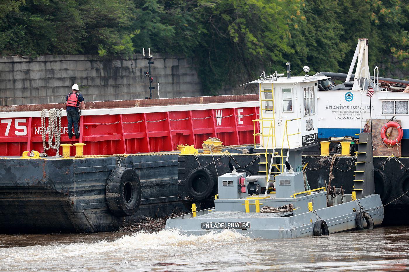 Crews free barge wedged under I-676 bridge and traffic resumes