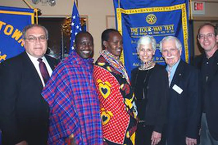 On hand as the Rotary Club of Doylestown donated $30,000 for a water project in Kenya were (from left): John E. Stanojev, past president; Francis Ole Sakuda, Maasai tribesman; Grace Salau, Maasai tribeswoman; Phyllis Eckelmeyer, founder of the Maasai Cultural Exchange Project; John Brown, committee chairman; and Ron Smith, past district governor.