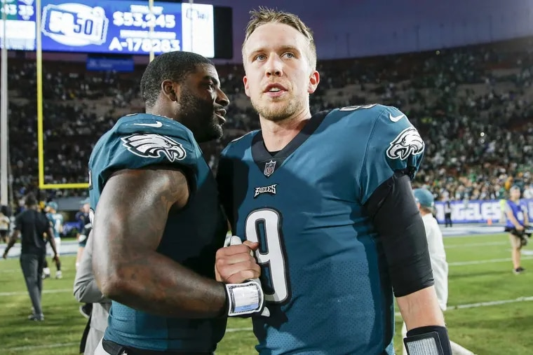 Eagles quarterback Nick Foles with teammate defensive end Vinny Curry after the Eagles beat the Los Angeles Rams on Sunday, December 10, 2017. YONG KIM / Staff Photographer