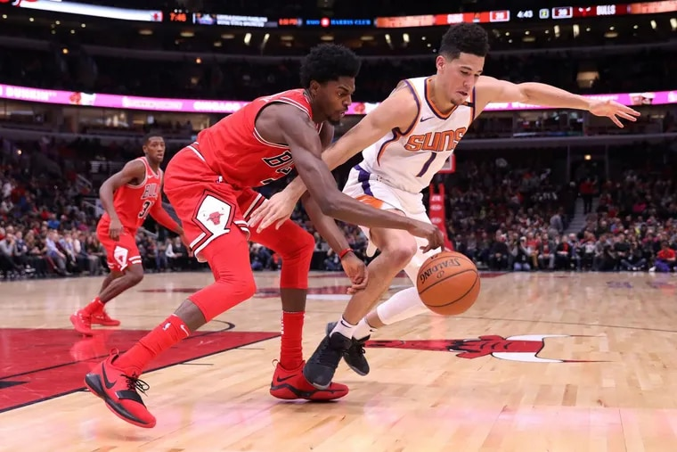 Justin Holiday (left) averages 13.6 points for the Bulls.