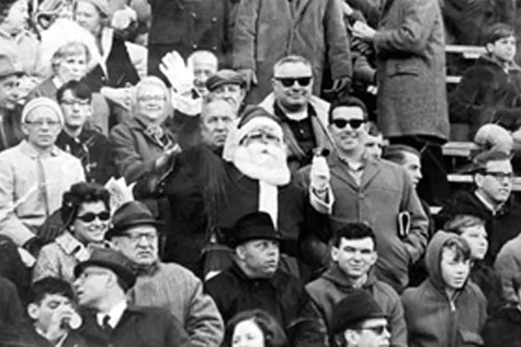 Frank Olivo playing Santa at an Eagles game in 1967, top. He was pelted with snowballs the next year. Right, during a 2008 anniversary event at Lincoln Financial Field.