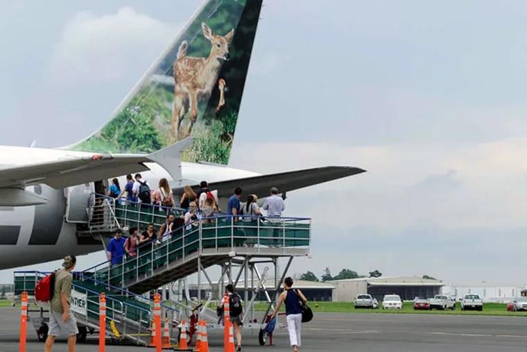 Passengers board a Frontier flight at Trenton-Mercer Airport. Frontier has trimmed some Trenton flights.