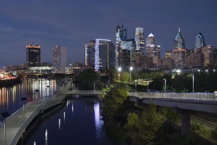 The Philadelphia skyline seen from the South Street Bridge over the Schuylkill River September 26, 2017 includes the still-under-construction Comcast Technology Center and Comcast Center; One and Two Liberty Place; the FMC Tower and Cira Centre South and the Boardwalk section of the Schuylkill River Trail.  TOM GRALISH / Staff Photographer