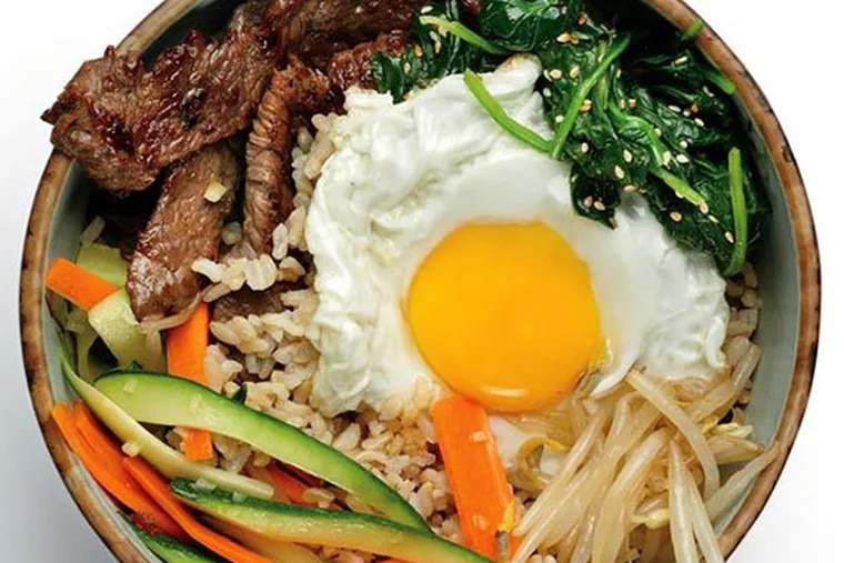 """Bi bim bap means """"mixed rice,"""" and bulgogi refers to meat that was marinated before cooking."""