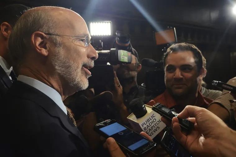 Democratic Gov. Tom Wolf speaks to reporters in his offices in July.