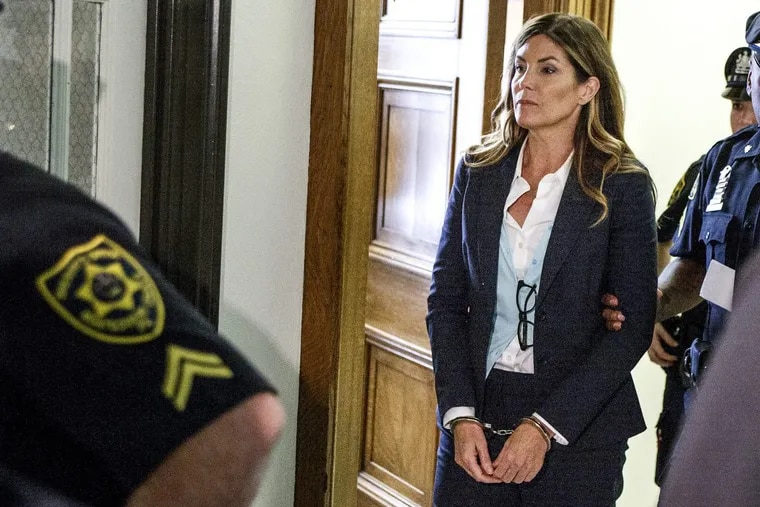 Former state Attorney General Kathleen Kane leaves Montgomery County Court in Norristown in handcuffs after her sentencing.
