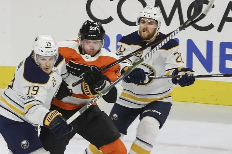 Jake Voracek (center), battling against two Sabres in a recent game, entered Wednesday as the NHL's fifth-leading scorer.