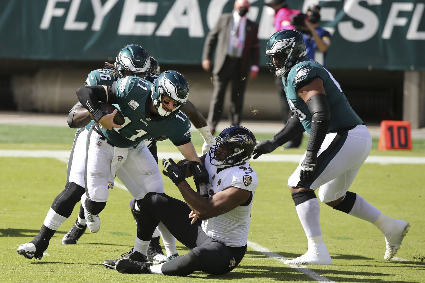 Eagles' offensive line, patched together with backups, finally collapses against Ravens