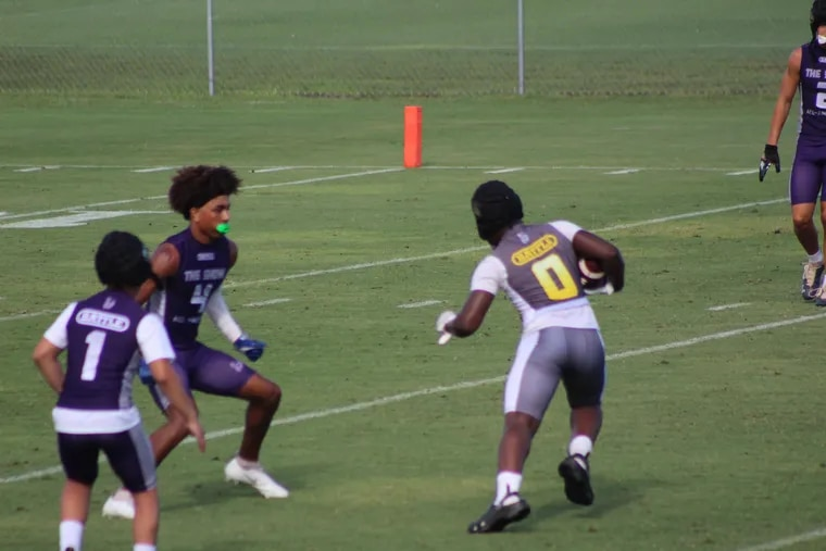 Jiaire Greene makes a catch and runs in his Crocs.