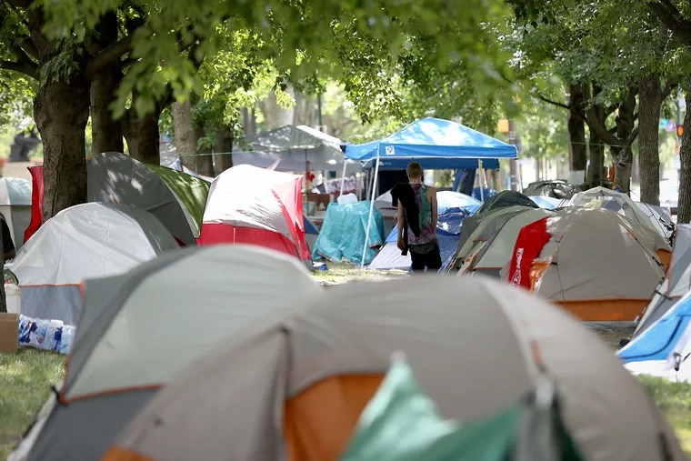 The encampment of homeless people on the Benjamin Franklin Parkway is entering its third week as city officials negotiate with organizers to ultimately close the site.