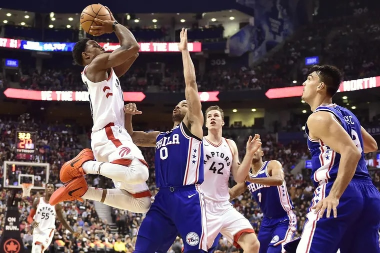 Raptors guard DeMar DeRozan (left) proved Thursday that he's tough for the Sixers to stop. He finished with career highs of 45 points and six three-pointers made.