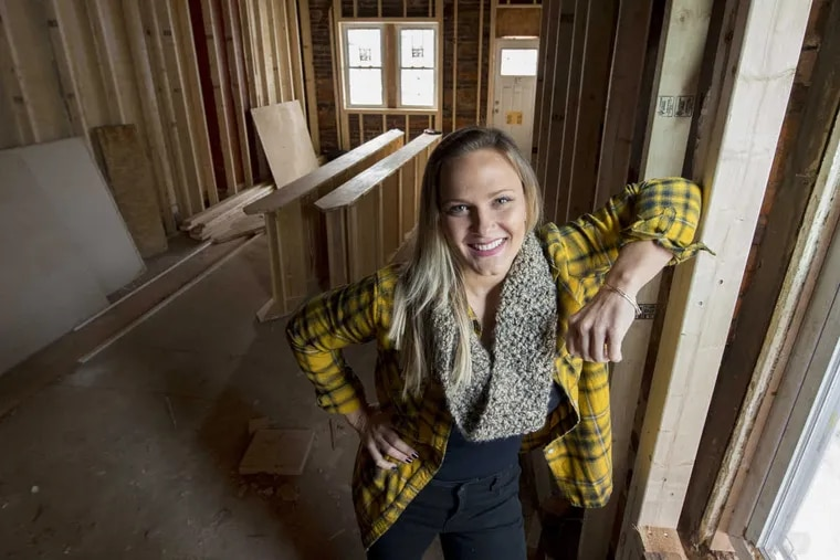Philadelphia home flipper Kelly Straka, 32, in pictured in a home she has gutted and is completely renovating on E. Susquehanna Street in the Fishtown neighborhood.