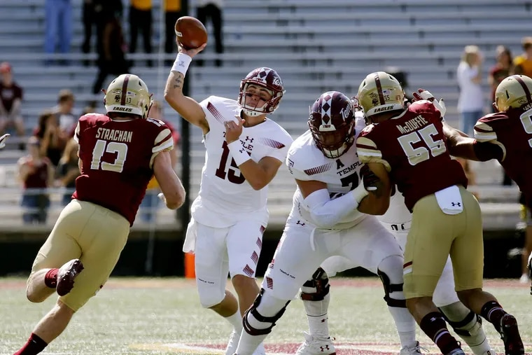 Temple quarterback Anthony Russo (15) looks to pass under pressure from Boston College linebacker Connor Strachan (13) during the first half of an NCAA college football game, Saturday, Sept. 29, 2018, in Boston. (AP Photo/Mary Schwalm)