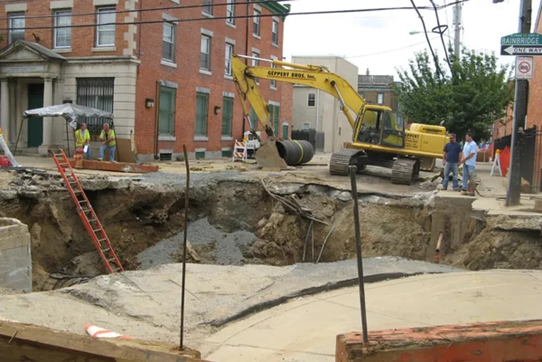When the water main pipe broke last year at 21st and Bainbridge streets, it caused $2 million in damages, according to claims filed by those affected.  (Photo provided by Bruce Amos)