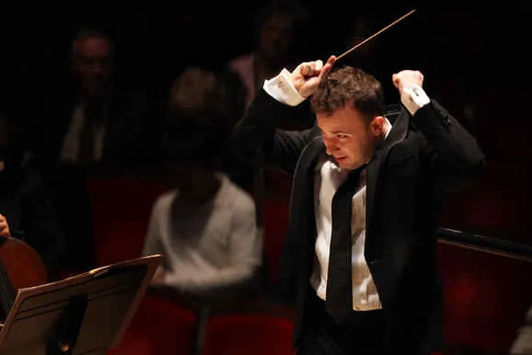 """Conducting the Philadelphia Orchestra at Verizon Hall in December: """"We've had two strong weeks with him,"""" said principal timpanist Don Liuzzi. """"We've seen enough to know he has a vitality about him and musical intelligence that we're excited about."""""""