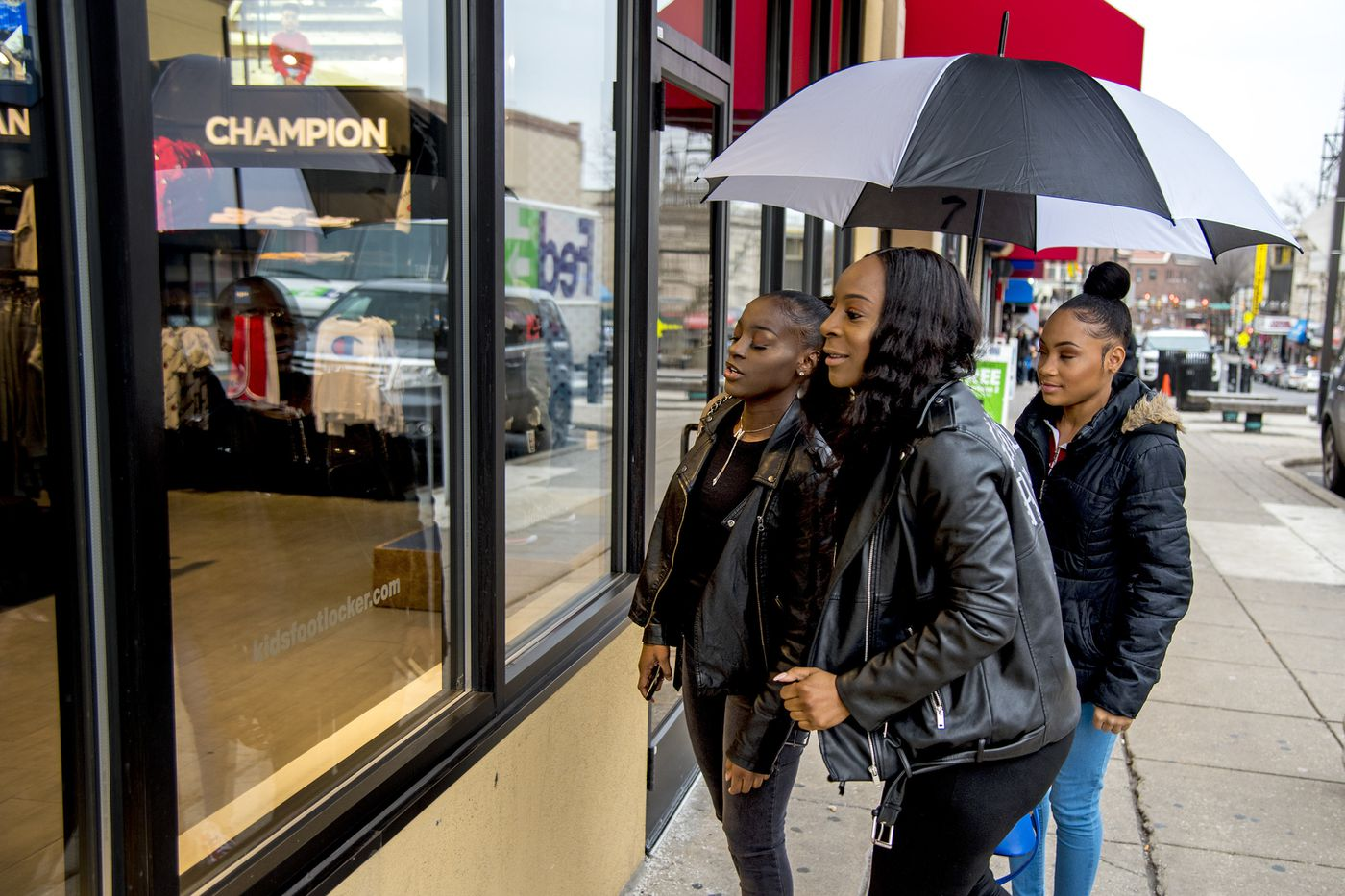 Years ago, Portia Smith (center) suffered postpartum depression and feared seeking care because of child welfare involvement. She window shops with daughters Nelly Smith (left), 19, and Najai Jones-Smith (right), 15.