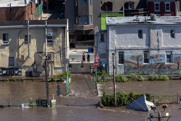 A view of the backside of Main Street Manayunk as seen from the Manayunk Bridge. Heavy rain from Hurricane Ida is creating problems with flooding in Philadelphia and region on Thursday, September 2, 2021.
