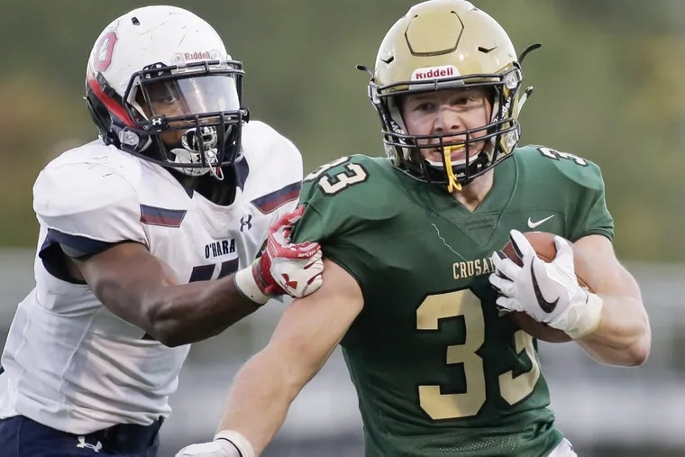 Lansdale Catholic's  Matt Casee (right) has rushed for 963 yards this season.
