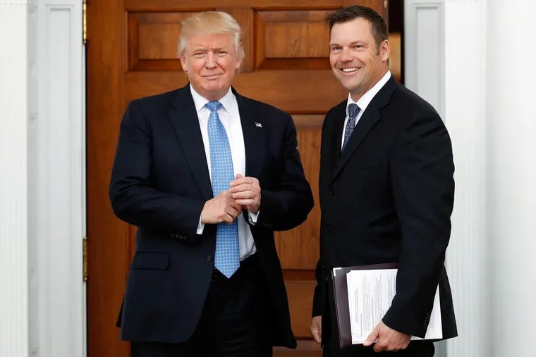Kansas Secretary of State Kris Kobach, the voter fraud commission's vice chairman, with President Trump in November.
