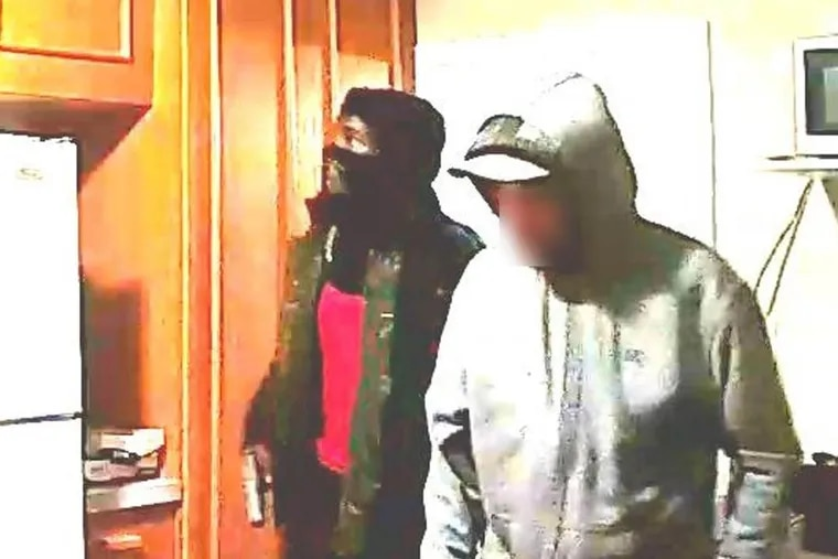A surveillance system picture of the suspects who authorities say shot Sylvia Williams, 38, of Pottstown, on the evening of Nov. 18 at her home on North Washington Street.
