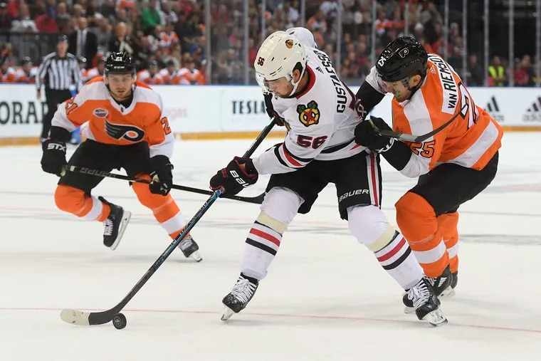 Chicago's Erik Gustafsson (left) and the Flyers' James van Riemsdyk battle for the puck during the NHL Global Series in Prague on Oct. 4. The Flyers won, 4-3, and the teams will have a rematch Thursday in Chicago.