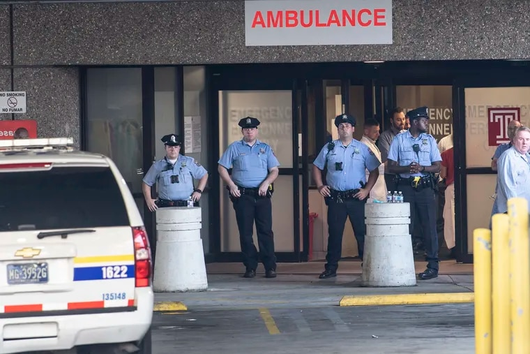 Philadelphia Police official gathered at the Emergency entrance of Temple University Hospital after a multiple police shooting in North Philadelphia.