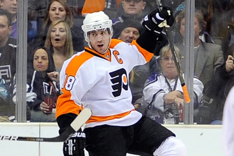 Flyers center Mike Richards celebrates one of his two goals in Thursday night's win over the Kings.  (AP Photo/Mark J. Terrill)